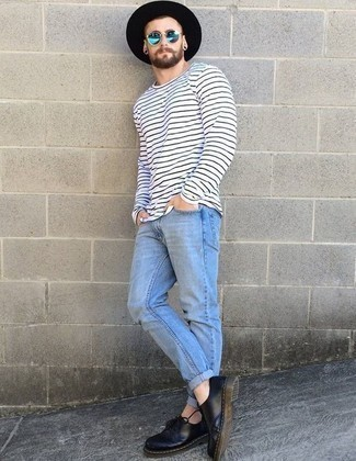 How to Wear a Black Wool Hat For Men: A white and navy horizontal striped long sleeve t-shirt and a black wool hat combined together are a match made in heaven for those who appreciate casual ensembles. On the fence about how to finish off this ensemble? Rock black leather derby shoes to dress it up.