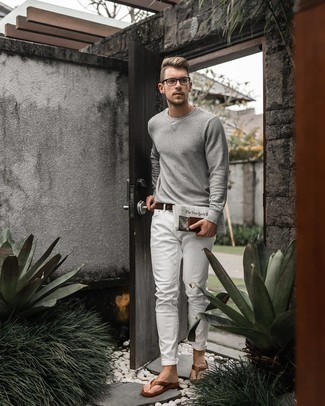 Grey Long Sleeve T-Shirt Outfits For Men: A grey long sleeve t-shirt and white jeans make for the ultimate casual style for any modern man. Brown leather flip flops are a surefire way to add a dose of stylish effortlessness to your outfit.