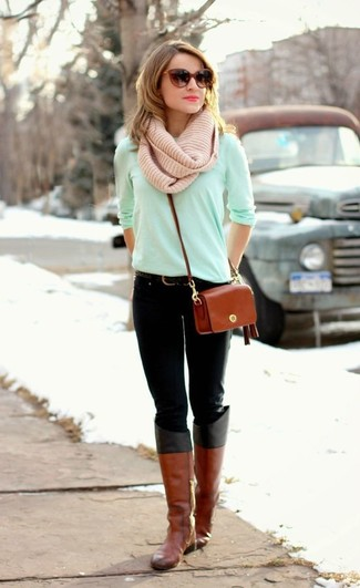 If you're scouting for a casual yet stylish look, make a mint long sleeve t-shirt and black jeans your outfit choice. Both garments are totally comfy and will look fabulous paired together. Balance this getup with Salvatore Ferragamo Knee Length Boots. Mastering transitional fashion is easy with style inspo like this.