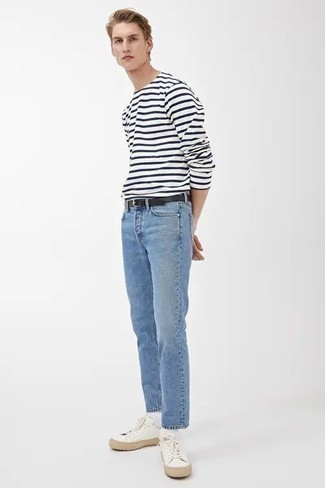 1200+ Outfits For Men In Their 20s: A white and navy horizontal striped long sleeve t-shirt and light blue jeans have become true off-duty styles. Introduce a pair of white canvas low top sneakers to the equation and the whole outfit will come together. This combination proves that as a gent in his twenties, you have a wide array of sartorial options.
