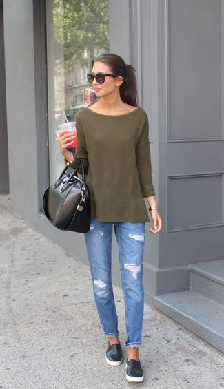 Nail glam in an army green long sleeve t-shirt and blue ripped jeans. Black leather slip-on sneakers will add a new dimension to an otherwise classic look.