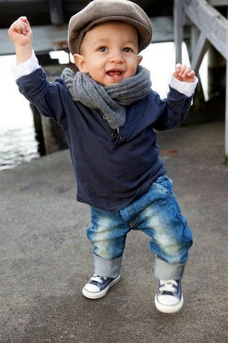 How to Wear a Grey Scarf For Boys: Go for a navy long sleeve t-shirt and a grey scarf for your child for a fun day out at the playground. This style is complemented really well with navy and white sneakers.