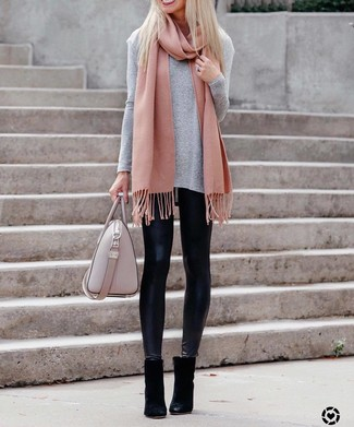 How to wear: grey long sleeve t-shirt, black leather leggings, black suede ankle boots, pink leather tote bag