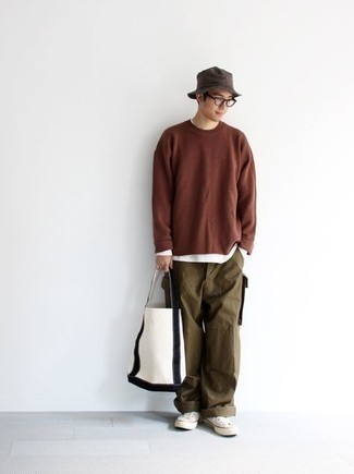 White Canvas Low Top Sneakers Outfits For Men: If you're all about feeling relaxed when it comes to fashion, this combo of a brown long sleeve t-shirt and olive cargo pants is totally you. The whole outfit comes together perfectly if you add a pair of white canvas low top sneakers to this getup.