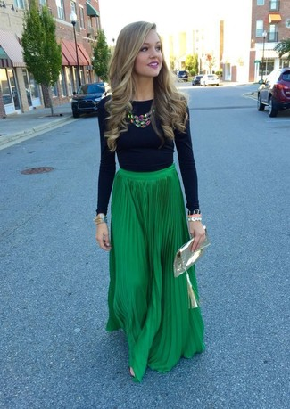 Step up your off-duty look in a black long sleeve t-shirt and a green pleated maxi skirt.