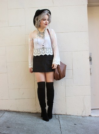 Try teaming a white lace long sleeve t-shirt with a black mini skirt for a comfortable outfit that's also put together nicely. Complement this look with black suede knee high boots.