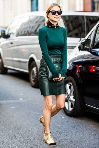 How to wear: teal long sleeve t-shirt, dark green leather mini skirt, gold cutout leather lace-up ankle boots, dark green leather clutch
