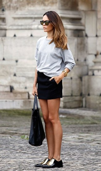 How to wear: grey long sleeve t-shirt, black mini skirt, black and gold leather oxford shoes, black leather tote bag