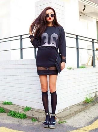 How to wear: black and white print mesh long sleeve t-shirt, black mesh pencil skirt, silver leather flat sandals, black knee high socks