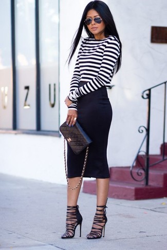 If you're a fan of classic pairings, then you'll like this combination of a white and black striped long sleeve t-shirt and a black pencil skirt. A pair of black suede heeled sandals will seamlessly integrate within a variety of outfits.