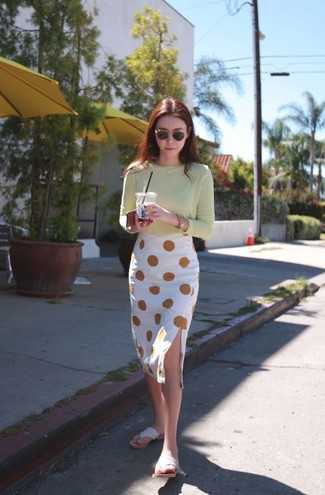 How to wear: mint long sleeve t-shirt, white polka dot pencil skirt, beige thong sandals, black and gold sunglasses