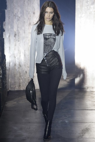 Choose a white and black print long sleeve t-shirt and a fanny pack to show off your styling smarts. Opt for a pair of black leather booties to instantly up the chic factor of any outfit. We love how great this outfit is come summer.