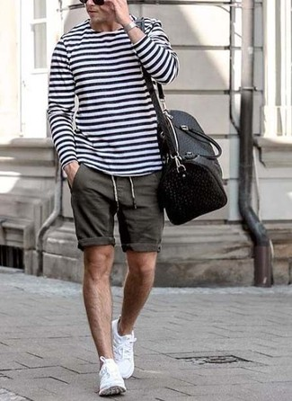 How to wear: white and navy horizontal striped long sleeve t-shirt, charcoal shorts, white athletic shoes, black leather holdall
