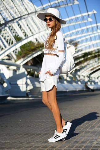 How to Wear a White Mesh Long Sleeve T-shirt For Women: A white mesh long sleeve t-shirt and white shorts are the kind of stylish casual items that you can wear a hundred of ways. To introduce a hint of stylish casualness to this outfit, add white low top sneakers to the mix.