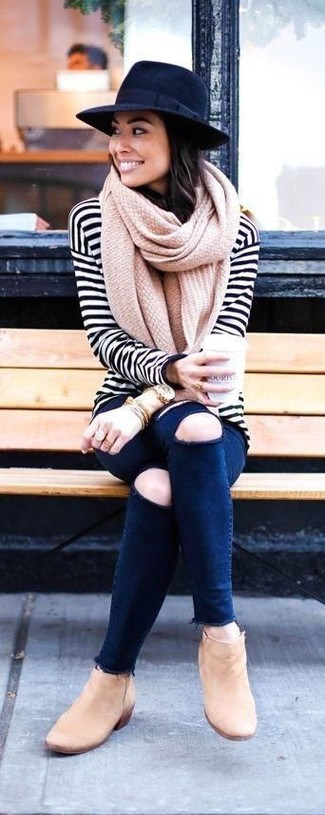 How to Wear a Navy Wool Hat For Women: A white and black horizontal striped long sleeve t-shirt and a navy wool hat worn together are an ultra covetable getup for fashionistas who appreciate casual getups. A pair of tan suede ankle boots will bring an instant sultry vibe to your ensemble.