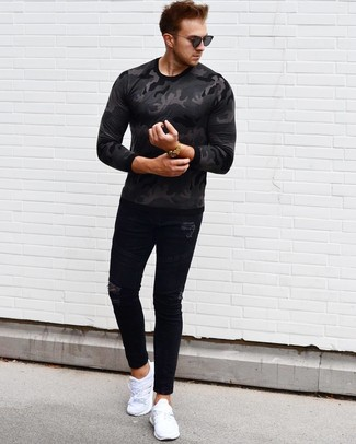 How to wear: charcoal camouflage long sleeve t-shirt, black ripped skinny jeans, white athletic shoes, black sunglasses