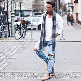 Pair a white long sleeve t-shirt with light blue destroyed skinny jeans to  effortlessly