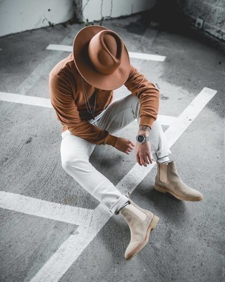 Beige Suede Chelsea Boots Outfits For Men: We all seek comfort when it comes to styling, and this edgy combo of a brown long sleeve t-shirt and white skinny jeans is a good illustration of that. You could take a more elegant route when it comes to footwear with a pair of beige suede chelsea boots.