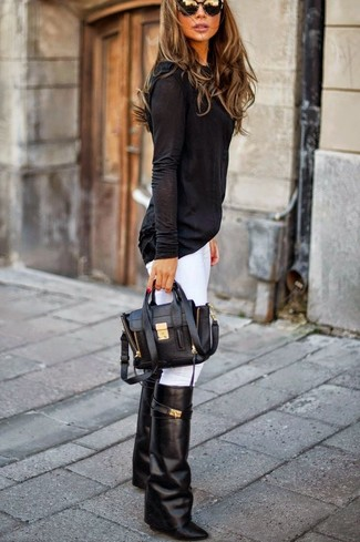 A black long sleeve t-shirt and white skinny jeans is a versatile combination that will provide you with variety. Consider black leather knee high boots as the glue that will bring your outfit together. This getup is super functional and will help you out in awkward transition weather.
