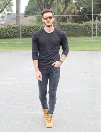 How to wear: charcoal long sleeve t-shirt, charcoal skinny jeans, tan low top sneakers, orange sunglasses