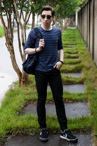 How to wear: blue horizontal striped long sleeve t-shirt, black skinny jeans, black and white star print low top sneakers, navy canvas backpack