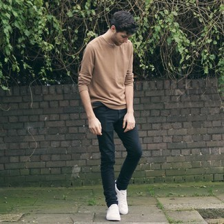Black Jeans with Beige Long Sleeve T-Shirt Outfits For Men: If you're on a mission for a bold casual but also sharp getup, try teaming a beige long sleeve t-shirt with black jeans. Our favorite of a multitude of ways to finish off this outfit is white canvas low top sneakers.