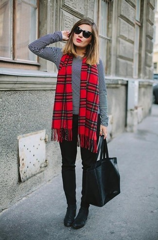 Black Long Sleeve T-shirt Outfits For Women: Why not opt for a black long sleeve t-shirt and black skinny pants? Both of these items are super practical and will look great married together. Black leather ankle boots will be the perfect addition to your look.