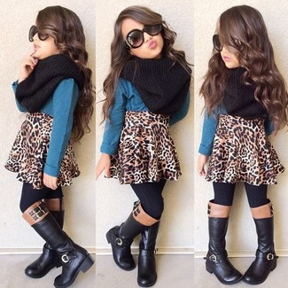 A teal long sleeve t-shirt and a brown leopard skirt are a combination that every stylish little girl should have in her wardrobe. This style is complemented perfectly with black boots.