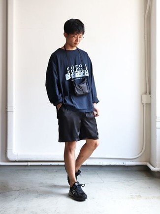 Black Sports Shorts Outfits For Men: Pair a navy print long sleeve t-shirt with black sports shorts for an off-duty look that's also easy to wear. On the shoe front, this ensemble pairs brilliantly with black athletic shoes.
