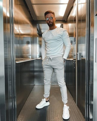 White and Black Leather Shoes with Pants Outfits For Men: For something more on the off-duty end, try this combo of a white long sleeve t-shirt and pants. Rounding off with a pair of white and black leather low top sneakers is a fail-safe way to give a hint of refinement to your ensemble.