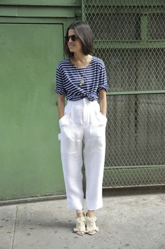 How to wear: navy and white horizontal striped long sleeve t-shirt, white linen wide leg pants, beige canvas wedge sandals, dark brown sunglasses
