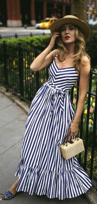 A white and navy vertical striped maxi dress and a khaki straw hat are a perfect combination to be utilised at the weekend. A pair of navy canvas flat sandals will be a stylish addition to your outfit. So if it's a warm summertime day and you want to look beyond chic without putting too much effort, this getup will do the job in no time.