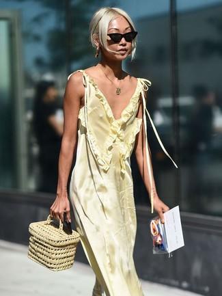 How to wear: yellow satin maxi dress, beige straw handbag, black sunglasses, gold pendant