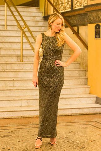 Consider wearing a gold maxi dress to effortlessly deal with whatever this day throws at you. Dress up this look with black and tan leather heeled sandals. So if it's a hot day and you want to look stylish without putting too much effort, this ensemble will do the job in no time flat.