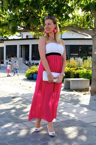 A neon pink maxi dress will showcase your sartorial self. Elevate your getup with white leather pumps.
