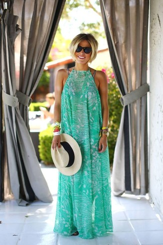 Wear a green print maxi dress for comfort dressing from head to toe. Make black leather thong sandals your footwear choice for a more relaxed aesthetic. What better pick for a hot summer afternoon?