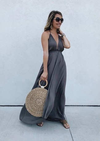 Tan Straw Tote Bag Outfits: If you're all about comfort dressing when it comes to your personal style, you'll love this incredibly chic combination of a charcoal maxi dress and a tan straw tote bag. Introduce a pair of tan leather thong sandals to your look and you're all done and looking smashing.