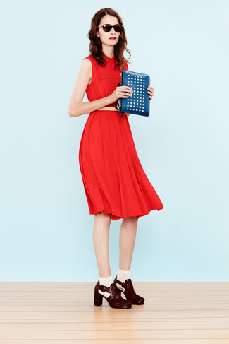 How to wear: red midi dress, burgundy leather ankle boots, blue studded leather clutch, beige leather belt