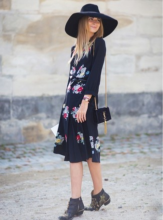 If it's comfort and ease that you're searching for in an outfit, choose a black floral chiffon midi dress. Add a glam twist to your ensemble with black studded leather ankle boots. This combination is our idea of perfection for those warmer days of spring.