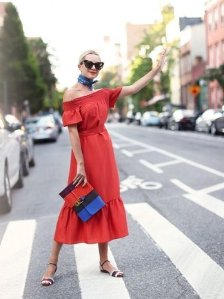 Nail glam in a red midi dress. Polish off the ensemble with multi colored leather heeled sandals.