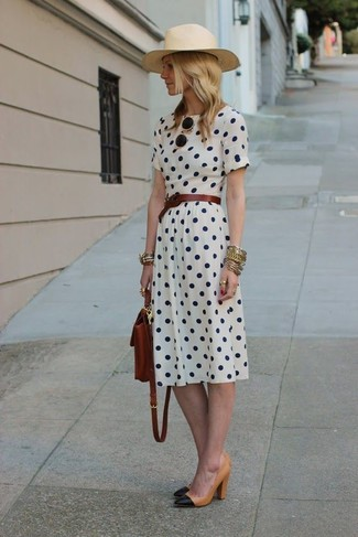 How to wear: white polka dot midi dress, black and tan leather pumps, dark brown leather backpack, dark brown leather belt