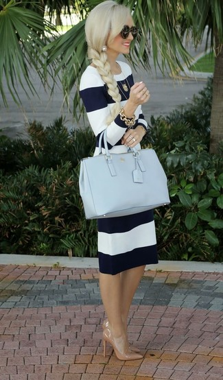 Make a navy and white striped midi dress your outfit choice for a refined yet off-duty ensemble. Elevate this ensemble with camel leather pumps.