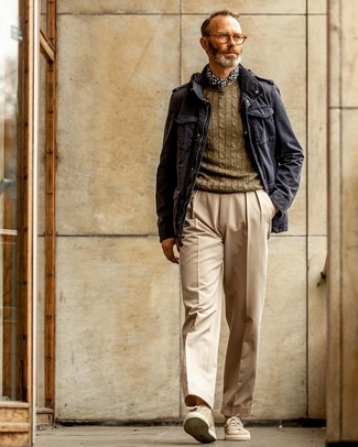 How to wear: navy military jacket, olive cable sweater, beige dress pants, beige suede low top sneakers