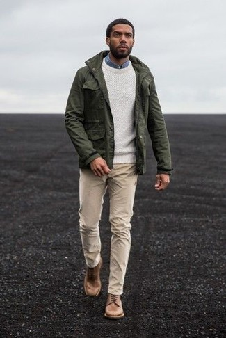 How to wear: olive military jacket, white crew-neck sweater, blue denim shirt, beige chinos