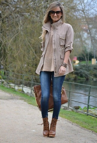 How to wear: grey military jacket, beige crew-neck sweater, blue denim leggings, brown leather lace-up ankle boots