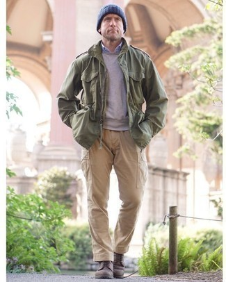 How to Wear an Olive Military Jacket For Men: Dress in an olive military jacket and khaki cargo pants for a practical ensemble that's also put together. And if you want to instantly lift up this getup with one piece, why not complement this look with a pair of dark brown leather casual boots?