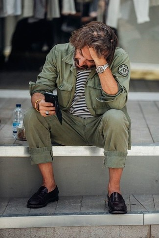 How to wear: olive military jacket, white and black horizontal striped crew-neck t-shirt, olive chinos, black leather loafers