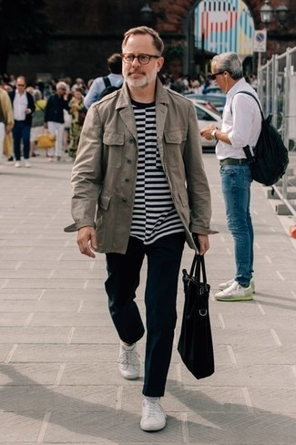 How to Wear a Black and White Horizontal Striped Crew-neck T-shirt For Men: You're looking at the hard proof that a black and white horizontal striped crew-neck t-shirt and black chinos are amazing when paired together in a relaxed casual outfit. White low top sneakers tie the look together.