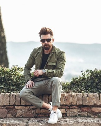 How to Wear Grey Chinos: An olive military jacket and grey chinos are veritable menswear must-haves if you're figuring out a casual closet that holds to the highest sartorial standards. For a more casual spin, why not complete this ensemble with a pair of white leather low top sneakers?