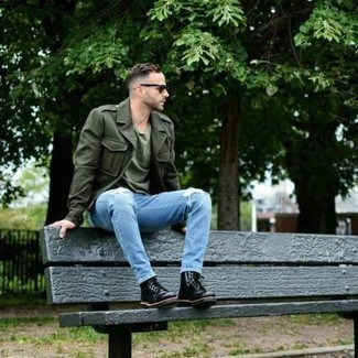 Olive Military Jacket Outfits For Men: Rock an olive military jacket with light blue ripped jeans for a neat and stylish outfit. Complement your ensemble with black leather casual boots for a dash of class.